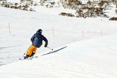 Skier racing through a Ski Cross Course in Australia. Skier racing through a Ski Cross Course - racing against the clock in the Australia Alps Stock Images