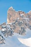 Snow covered alpine mountain peak. A winterly alpine mountain peak covered in snow Stock Photo