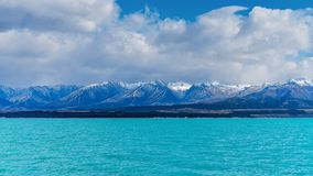 The Snow Covered Alps Called The Remarkables. The snow covered alpine mountains called The Remarkables, as seen across Lake Wakatipu, Queenstown, New Zealand Stock Image