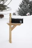 Snow covered american post box Royalty Free Stock Image