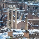 Snowy Pillars of the Roman Forum. Snow-covered and ancient Roman Forum left abandoned and closed on a snow day in Rome Stock Photo