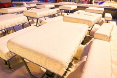 Snow-covered attractions in the old park stock photo