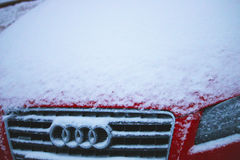 Snow-covered Audi hood stock photography