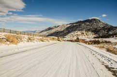 Snow-covered Backroad in Montana. Snow-covered backroad in the big sky state of Montana stock photography