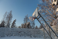 A snow covered basketball court Stock Image