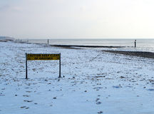 Snow covered beach. Scenic view of snow covered beach and coastline Royalty Free Stock Photo