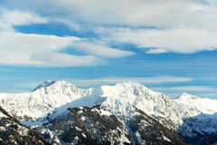 Snow covered beautiful alpine mountain peaks Stock Photos