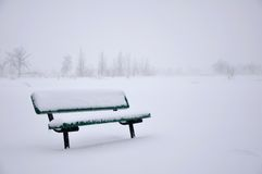 Snow covered bench Royalty Free Stock Photos