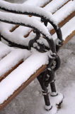 Snow covered bench Royalty Free Stock Photo
