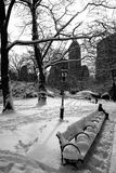Snow covered bench in Central Park in New York Stock Photos