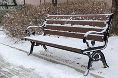 A snow covered bench Stock Photo