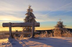 Snow Covered Bench on Mountain Top during Sunset Royalty Free Stock Photo