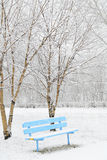 Snow-covered bench in the Park Royalty Free Stock Photography
