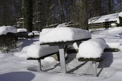 Snow Covered Bench And Table. Left on an abandoned terrace Royalty Free Stock Image