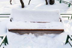 Snow-covered bench at urban square in winter. Snow-covered bench at urban square in Moscow city in winter morning Stock Photography