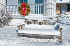 Snow Covered Bench on Winter Day royalty free stock photos