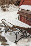Snow-covered bench in the winter garden Stock Photography