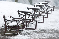 Snow covered benches Royalty Free Stock Image