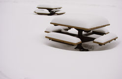 Snow covered benches in a park Stock Photography
