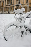 Snow covered bicycle. In Oxford's Broad Street stock photo