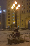 Snow-covered bicycles leaning against the lamppost. Stock Photo
