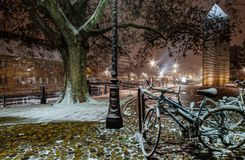 Snow-covered bicycles on the street, Strasbourg, night view, Chr Royalty Free Stock Image