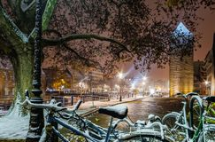 Snow-covered bicycles on the street, Strasbourg, night view, Chr Stock Photography