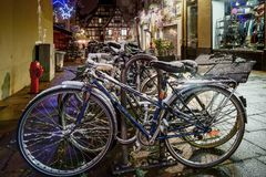 Snow-covered bicycles on the street, Strasbourg, night view, Chr Royalty Free Stock Images