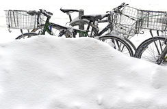 Snow covered bicycles on street after winter snowstorm Stock Photography