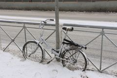 Snow-covered bike in a blizzard stock photo