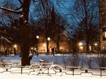Snow Covered Bike Near Fence during Nighttime Royalty Free Stock Photography