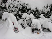 Snow Covered Bikes. Bicycles after heavy snowfall in Munich, the heaviest since 100 years royalty free stock images