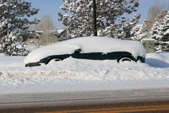 Snow covered black car Stock Image