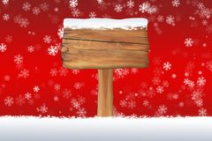 Snow covered blank sign on a Christmas snowflake background Royalty Free Stock Images