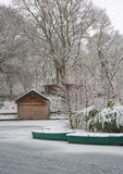 Snow covered boat hut Stock Images