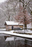 Snow covered boat hut Royalty Free Stock Image