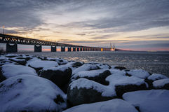 Snow covered boulder by the Øresund Bridge Royalty Free Stock Images