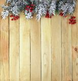 Branches of a Christmas tree in the snow on a wooden background. stock photos