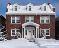 Snow covered brick house Royalty Free Stock Images