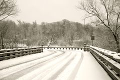 Snow covered bridge Stock Photos