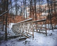 Snow covered bridge royalty free stock photography