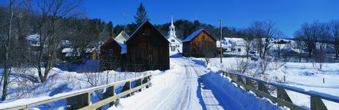 Snow covered bridge in New England town Royalty Free Stock Photo