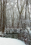 Snow covered bridge over creek. Snow covered bridge over a creek in Kent County MI Royalty Free Stock Images