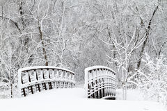 Snow covered bridge and walkway stock photo