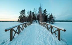 Snow covered bridge in winter Stock Image