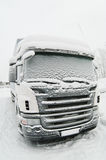 Snow-covered cab of the truck Stock Photos