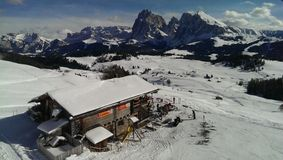 Snow Covered Cabin in the Dolomites Royalty Free Stock Images