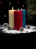 Snow Covered Candles at Night with cones- Vertical Stock Photography