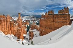 Snow Covered Canyon Under Blue and White Sunny Cloudy Sky Stock Images