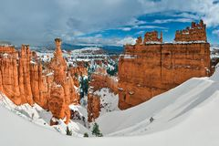 Snow Covered Canyon Under Blue and White Sunny Cloudy Sky Stock Photo